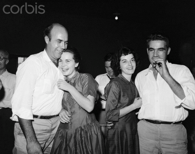 Roy Bryant (left), smokes a cigar as his wife happily embraces him. His half brother, J.W. Milam and his wife show jubilation. Bryant and Milam were cleared by an all white, male jury of the charge of having murdered Till, a 14-year-old Chicago boy who was black. The jury was out just one hour and 7 minutes.