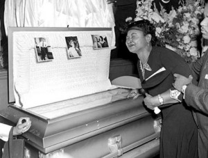 Emment Till's mother (Mamie Till) by his open casket