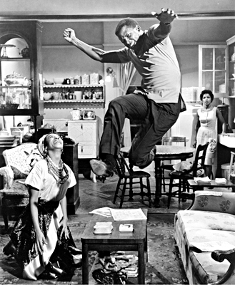 Sidney Poitier in an exuberant moment from the 1961 film of A Raisin in the Sun, with actresses Diana Sand and Ruby Dee. All three had appeared in the original Broadway production.